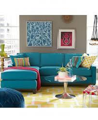 exciting elegant blue ocarina ocean slipcovered sectional sofa with stunning round glass table and yellow rug