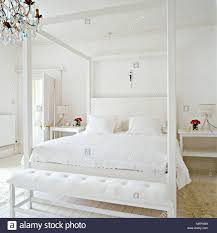 bedroom minimalist. A Modern Minimalist White Bedroom With Double Four Poster Bed Upholstered Headboard Bench Seat Bedside Tables R