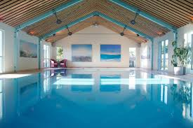 residential indoor lap pool. Decorations, Luxury House Swimming Pool With Violin Shapes Pools Amusing Indoor Blue Ornament At Modern Residential Lap P