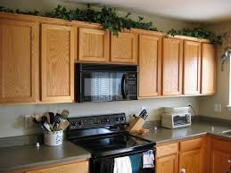 Empty Kitchen Wall Kitchen Decorating Above Kitchen Cabinets With Plates In