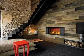 contemporary red chair with stone wall decor and wooden fireplace design for natural living room ideas