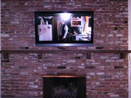 52 sony bravia plasma mounted over brick fireplace