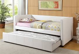 Modern trundle beds made of white leather with cute bedding set and  greeneries for fresh appearance