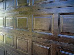 it s a quick and very cost effective faux wood door effect until the day we can afford to make the investment in a beautiful real wood door