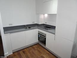 All The Fittings Inside The Apartment Are New, Including This White Kitchen
