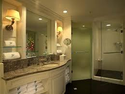 guest bathroom. luxury guest bathroom ideas using white wooden vanities and towel storage shelf also cubicle shower with ceiling lighting