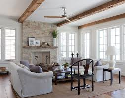 living room with stone fireplace. stacked stone fireplace with wood mantle living room beach style natural beams ceiling t