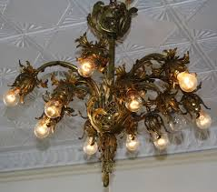 ornate twelve light cast iron and brass chandelier has that extremely hard to find asset of the lights pointing down beautify your home and see what you