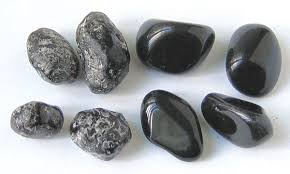 here are some tumbled and polished pieces of obsidian obsidian is mineral like but not a true mineral because as a glass it is not crystalline