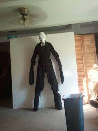 picture of slender man costume on stilts