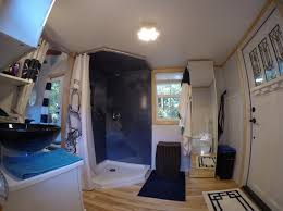 tiny house bathrooms. larger luxury bathroom with decorative shower wall panels in a custom tiny home north carolina house bathrooms