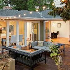 home plans design with furniture patio and wooden deck at twilight