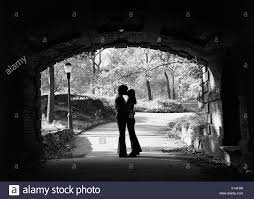 At Of Anonymous Photo Embracing Young Stock 86766339 Couple Kissing Silhouette Alamy - 1960s