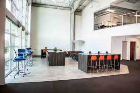 Image Hgtv 2017 Open Office Space Interior Design Tall Chairs And Desks On Main Floor Conference Room Tangram Interiors Tips To Develop Your Office Interior Design Tangram Interiors