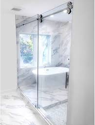 to strengthen its portfolio of frameless shower doors c r laurence has introduced its cambridge bypass sliding shower door system