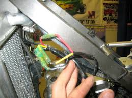 lights out klx klr 125 140 250 300 thumpertalk heres a picture of where the light harness begins on the side of the frame behind shroud the yellow wire is the power feed to the light switch the red
