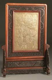 a very fine oriental fireplace screen elaborately pierced frame with dragons bronze insert of sho