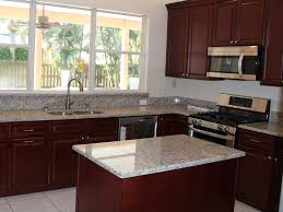 granite kitchen and bath. kitchen hd; with tan cabinets granite and bath a