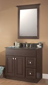 bathroom brown polished wooden narrow vanities with black top and sink plus rectangle mirror on