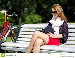 Teens Sit Back To Back On A Park Bench And Check Their Smartphones Sit Bench