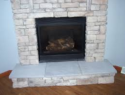 stone fireplace with granite hearth