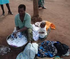 black man washing clothes. Plain Black Image Throughout Black Man Washing Clothes O