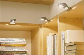 home library lighting. wood book shelves with small lighting fixtures for modern home library design o