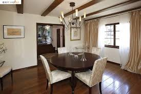 a nearby dining room continues the architectural concepts while a winning kitchen is available for parties entertaining or a just quiet evening by the