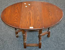 lotto 29 an old charm oak dropleaf occasional table model 1493 oval top