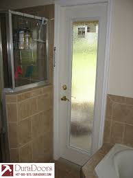 in addition to our beautiful front entry doors that we are known for we also offer doors for almost any area of the home this is a bathroom door leading