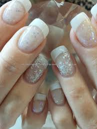 White acrylic tips with glitter acrylic and freehand snowflake ...