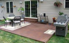 Concrete patio designs Simple Riveting Stain Or Paint Concrete Patio On Brown Stain Paint Colours Also Set Of Vintage Cast Iron Garden Chairs And Large Round Dining Table With Pinterest 58 Best Concrete Patio Ideas Images Gardens Landscaping Patio