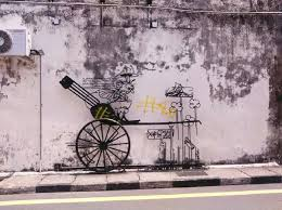 a wall metal artwork depicting a rickshaw was also vandalised pix courtesy of nst reader on famous wall art in penang with famous penang wall art vandalised with yellow paint new straits