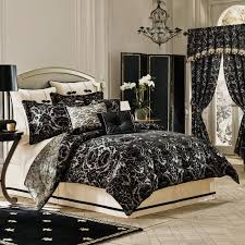 classic bedroom interior with black patterned comforter and dry sets as well as gray