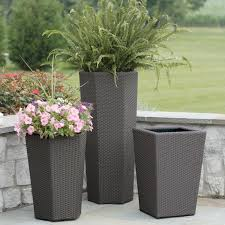 modern tall outdoor resin planters with exotic wicker vista