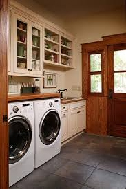 unfortunately if you do not have a front load washer and dryer this project will not be able to work for your setup as the countertop would get rid of the