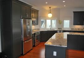 the graphite painted finish on the cabinetry creates high contrast