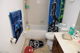 the bathroom in mateen s home has a star wars theme too with the towel curtain