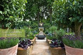 GAP Gardens  Spring Border In Kitchen Garden Containing Underplanting Fruit Trees