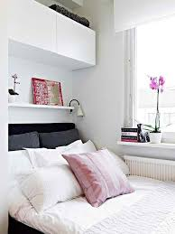 Over bed, and on sides!! Perfect! - Use Ikea picture ledges... Small  bedroom storage over bed. #KBHomes | Home decor ideas | Pinterest | Small