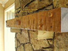 wood mantel with stone corbels