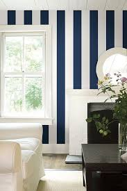 a smart dark navy blue and off white wide striped wallpaper