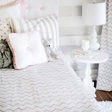 inspired by the popular chevron pattern our peace love and pink bedding collection is fun for a new big girl room pink gray and white give a clean
