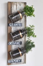 A wooden board, mason jars, herbs and a few other supplies are required to  complete this DIY project.