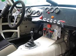les gonda s mgb gt v race car electrical fuses are mounted conveniently on the center console to the right of them is a second engine kill switch it also disconnects the battery