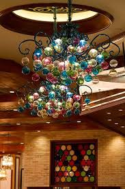 is the biggest chandelier in the world suspended under a glazed skylight steelman partners based in las vegas designed the lighting created by
