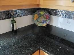 uba tuba granite counter top w glass mosaic and subway back splashtransitional kitchen seattle