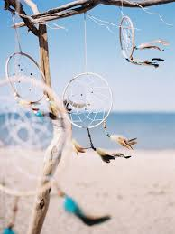 Beach Dream Catchers Dream catcher hanging on beach in front of sea PREMIUM STOCK 1