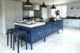 navy and white kitchen blue cabinets light walls rugs kitche