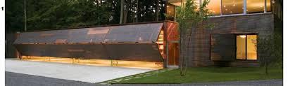 bi fold garage doorsLake Home in New York uses Four Designer Bifold Garage Doors